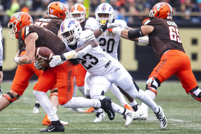Western Michigan Broncos linebacker Treshaun Hayward (23) sacks Bowling Green Falcons quarterback Grant Loy (13) during the first quarter of an NCAA college football game in Kalamazoo, Mich., on Saturday, Oct. 26, 2019. (Joel Bissell/Kalamazoo Gazette via AP)