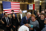 Democratic presidential candidate former Vice President Joe Biden greets audience members during a community event, Wednesday, Oct. 16, 2019, in Davenport, Iowa. (AP Photo/Charlie Neibergall)