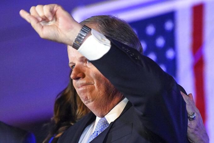 Sen. Doug Jones, D-Alabama, gestures during his concession speech Tuesday, Nov. 3, 2020, in Birmingham, Ala. Jones lost to Republican Tommy Tuberville. (AP Photo/Julie Bennett)