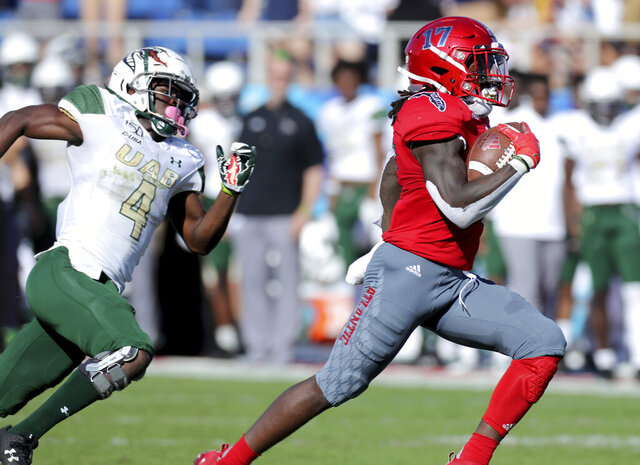 Florida Atlantic's Deangelo Antoine runs to the end zone for a touchdown as UAB'S Starling Thomas V chases during an NCAA college football game against UAB for the Conference USA championship, Saturday, Dec. 7, 2019, in Boca Raton, Fla. (Mike Stocker/South Florida Sun-Sentinel via AP)