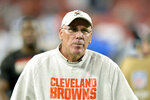FILE - In this Aug. 29, 2019, file photo, Cleveland Browns general manager John Dorsey walks on the field after an NFL preseason football game between the Detroit Lions, in Cleveland. The Browns and Dorsey have mutually agreed to part ways the team announced Tuesday, Dec. 31, 2019. (AP Photo/David Richard, File)