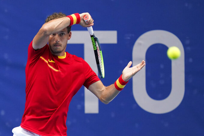 Pablo Carreno Busta, of Spain, returns to Karen Khachanov, of the Russian Olympic Committee, during the semifinal round of the men's tennis competition at the 2020 Summer Olympics, Friday, July 30, 2021, in Tokyo, Japan. (AP Photo/Patrick Semansky)