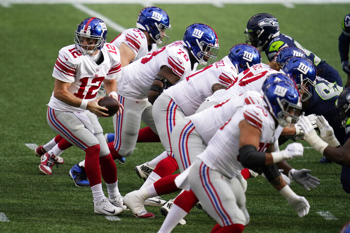 New York Giants quarterback Colt McCoy (12) takes a snap at the line of scrimmage during the first half of an NFL football game against the Seattle Seahawks, Sunday, Dec. 6, 2020, in Seattle. (AP Photo/Elaine Thompson)