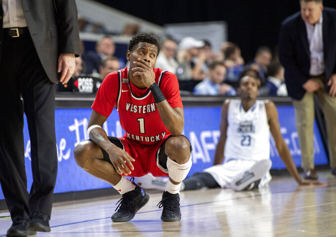 Western Kentucky guard Lamonte Bearden (1) waits to check in late in the second half of the team's NCAA college basketball game against Old Dominion for the Conference USA men's tournament championship, Saturday, March 16, 2019, in Frisco, Texas. Old Dominion won 62-56. (AP Photo/Jeffrey McWhorter)