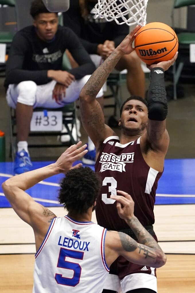 Louisiana Tech guard Kalob Ledoux (5) defends against a shot by Mississippi State guard D.J. Stewart Jr. (3) in the first half of an NCAA college basketball game in the semifinals of the NIT, Saturday, March 27, 2021, in Frisco, Texas. (AP Photo/Tony Gutierrez)
