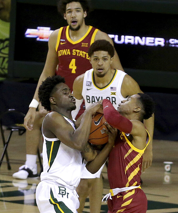 Baylor guard Adam Flagler (10), left, and Iowa State guard Tyler Harris (1) tie for a held ball in the second half of an NCAA college basketball game, Tuesday, Feb. 23, 2021, in Waco, Texas. (AP Photo/Jerry Larson)
