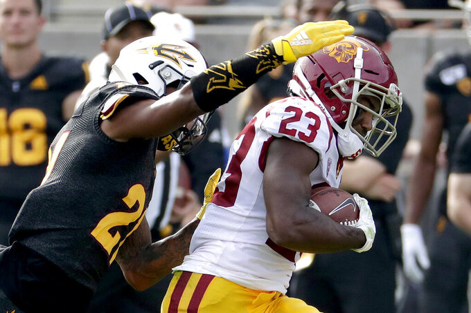 Southern California running back Kenan Christon (23) runs for a touchdown as Arizona State defensive back Jack Jones (21) defends during the first half of an NCAA college football game, Saturday, Nov. 9, 2019, in Tempe, Ariz. (AP Photo/Matt York)