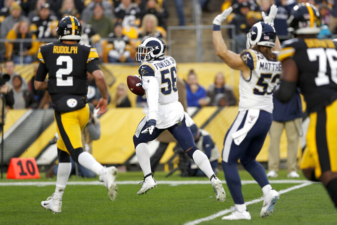 Los Angeles Rams defensive end Dante Fowler (56) heads for the end zone for a touchdown after recovering a fumble during the first half of an NFL football game against the Pittsburgh Steelers in Pittsburgh, Sunday, Nov. 10, 2019. (AP Photo/Keith Srakocic)