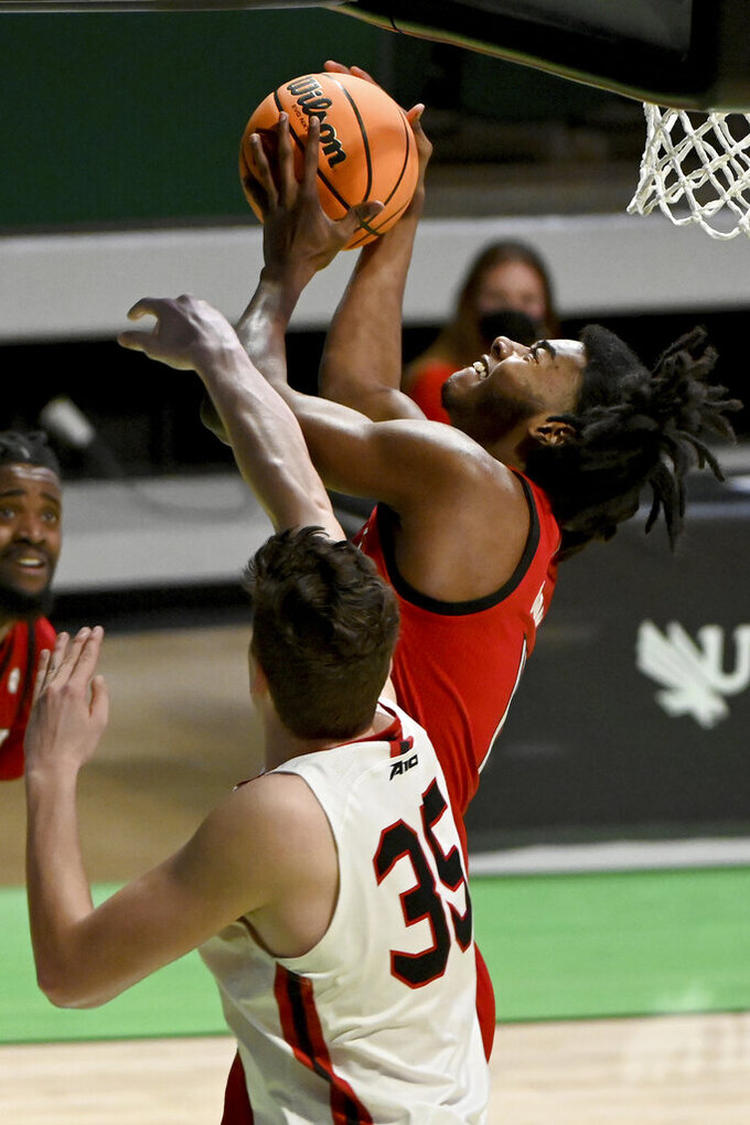 North Carolina State forward Jaylon Gibson (11) goes up for a shot on Davidson forward Luka Brajkovic (35) in the second half of an NCAA college basketball game in the first round of the NIT, Thursday, March 18, 2021, in Denton, Texas. North Carolina State won 75-61. (AP Photo/Matt Strasen)