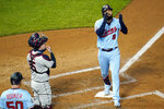 Minnesota Twins' Marwin Gonzalez, right, celebrates his two-run home run off Cleveland Indians pitcher Zach Plesac in the second inning of a baseball game Saturday, Sept. 12, 2020, in Minneapolis. Indians catcher Roberto Perez, second from left, looks on. (AP Photo/Jim Mone)