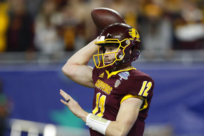 FILE - In this Dec. 7, 2019, file photo, Central Michigan quarterback Quinten Dormady throws during the first half of the Mid-American Conference championship NCAA college football game against Miami of Ohio in Detroit. Central Michigan and San Diego State meet Saturday, Dec. 21, 2019, in the New Mexico Bowl in Albuquerque, N.M. in a game expected to be a defensive battle. (AP Photo/Carlos Osorio,File)