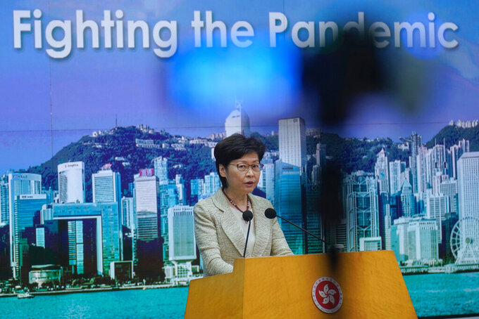 Hong Kong Chief Executive Carrie Lam listens to reporters' questions during a press conference in Hong Kong, Tuesday, May 4, 2021. Lam said on Tuesday that the government has not decided on compulsory vaccination requirement for foreign domestic workers. (AP Photo/Vincent Yu)