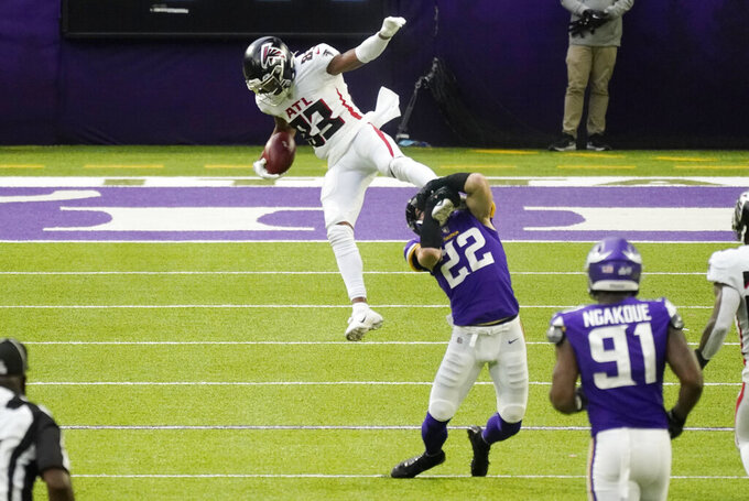Atlanta Falcons wide receiver Russell Gage (83) is tackled by Minnesota Vikings safety Harrison Smith (22) after catching a pass during the first half of an NFL football game, Sunday, Oct. 18, 2020, in Minneapolis. (AP Photo/Jim Mone)