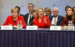 German Chancellor Angela Merkel, from left, and German Environment Minister Svenja Schulze and Chilean Environment Minister Carolina Schmidt attend the 10th Petersberger Klimadialog climate conference in Berlin, Germany, Tuesday, May 14, 2019. (Tobias Schwarz/Pool via AP)