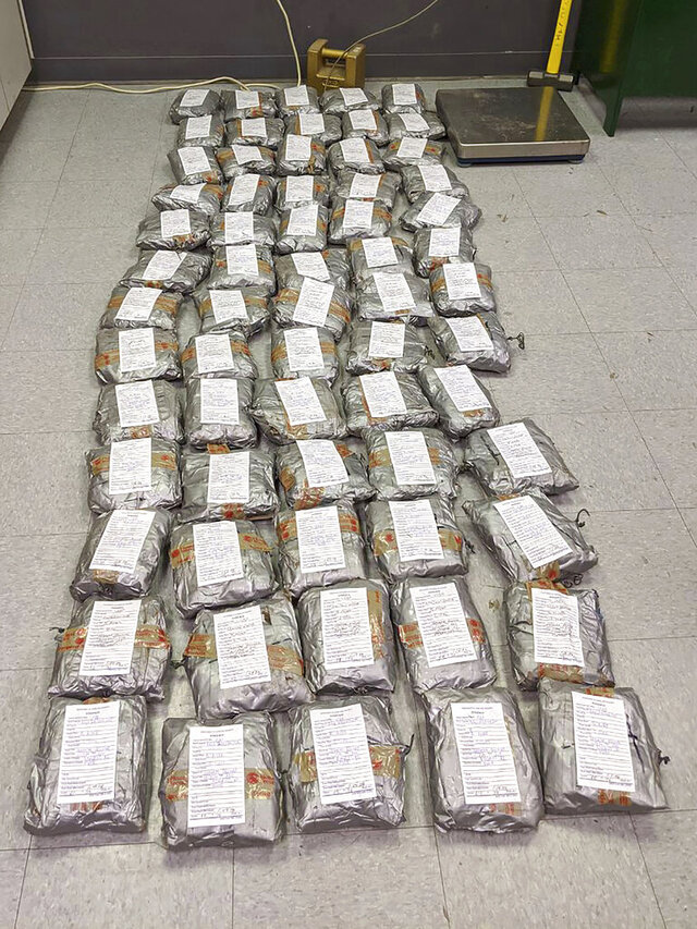 This undated photo provided by U.S. Customs and Border Protection shows some of over 165 pounds (75 kilograms) of suspected methamphetamine seized after smugglers tried to float it across the border from Nogales, Mexico, by roping together dozens of packages and sending them through an underground drainage tunnel into Arizona, federal officials said Friday, Jan. 24, 2020. Border Patrol agents in Nogales, Ariz. on Jan. 17 arrested two Mexican men after they were seen retrieving the 70 packages and stuffing them into duffel bags on the Arizona side, according to a U.S. Customs and Border Protection statement. (U.S. Customs and Border Protection via AP)