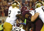 Notre Dame running back Dexter Williams (2) lunges forward for a touchdown during the first half of an NCAA college football game against Virginia Tech in Blacksburg, Va., Saturday, Oct. 6, 2018. (AP Photo/Steve Helber)
