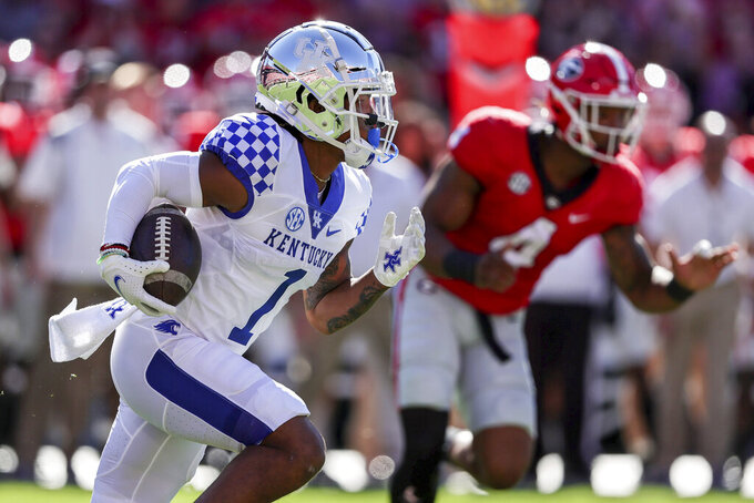 Kentucky wide receiver Wan'Dale Robinson (1) carries the ball against Georgia during the first half of an NCAA college football game Saturday, Oct. 16, 2021 in Athens, Ga. (AP Photo/Butch Dill)