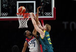 Australia's Jock Landale (13) goes to the basket over United States's Kevin Durant (7) during men's basketball semifinal game at the 2020 Summer Olympics, Thursday, Aug. 5, 2021, in Saitama, Japan. (AP Photo/Eric Gay)