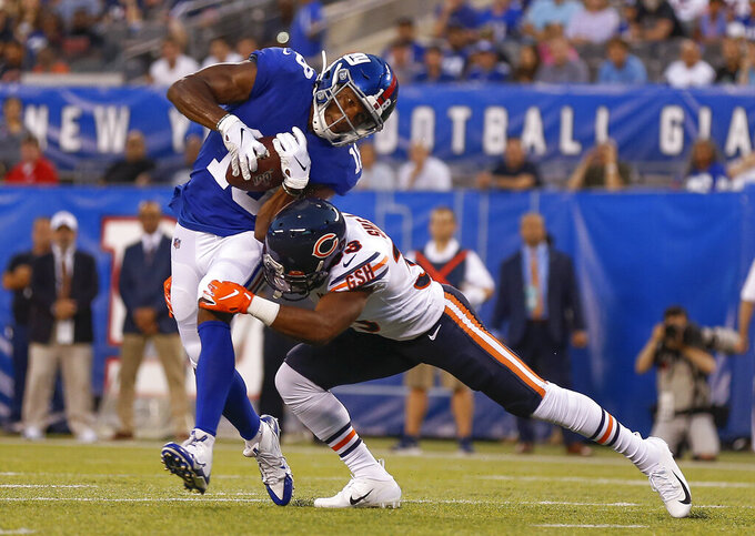 New York Giants wide receiver Bennie Fowler (18) avoids a tackle by Chicago Bears cornerback Duke Shelley (33) during the first quarter of a preseason NFL football game, Friday, Aug. 16, 2019, in East Rutherford, N.J. (AP Photo/Adam Hunger)