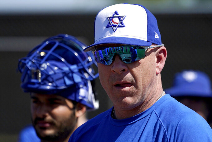 Israel Olympic baseball manager Eric Holtz watches his team practice at Salt River Fields spring training facility, Wednesday, May 12, 2021, in Scottsdale, Ariz. Israel has qualified for the six-team baseball tournament at the Tokyo Olympic games which will be its first appearance at the Olympics in any team sport since 1976. (AP Photo/Matt York)