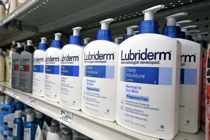 FILE- This Nov. 14, 2018, file photo shows Lubriderm, a Johnson & Johnson product, on display at a market in Pittsburgh. Johnson & Johnson reports financial results Tuesday, Oct. 14, 2019. (AP Photo/Gene J. Puskar, File)
