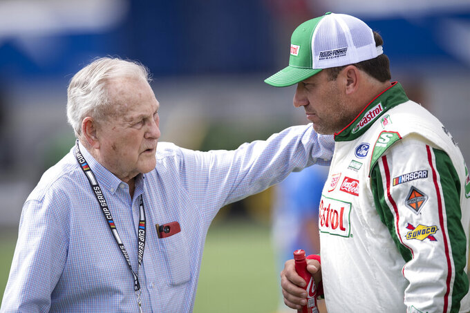 Driver Ryan Newman, right, and Humpy Wheeler have a conversation prior to a NASCAR Cup Series auto racing race at Charlotte Motor Speedway, Sunday, Oct. 10, 2021, in Concord, N.C. (AP Photo/Matt Kelley)