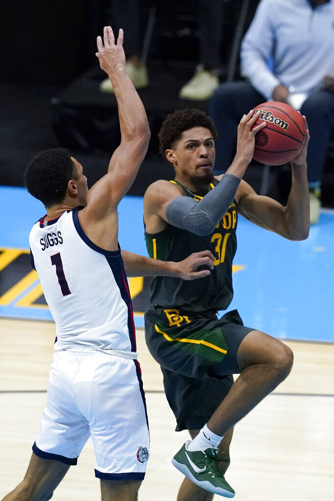 Baylor guard MaCio Teague (31) drives to the basket ahead over Gonzaga guard Jalen Suggs (1) during the second half of the championship game in the men's Final Four NCAA college basketball tournament, Monday, April 5, 2021, at Lucas Oil Stadium in Indianapolis. (AP Photo/Darron Cummings)