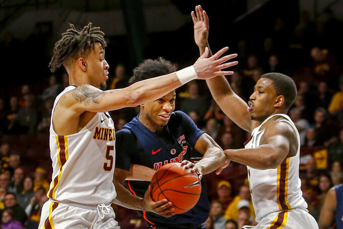 Illinois' Trent Frazier (1) tries to go between Minnesota's Amir Coffey (5) and Isaiah Washington (11) during the second half of an NCAA college basketball game Wednesday, Jan. 30, 2019, in Minneapolis. (AP Photo/Bruce Kluckhohn)
