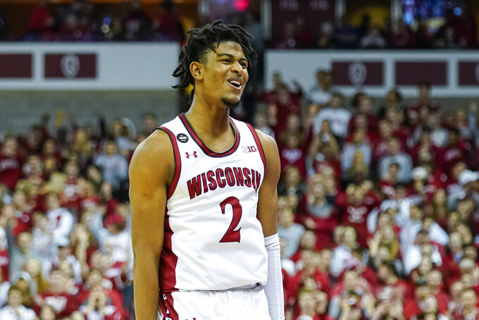 Wisconsin's Aleem Ford (2) reacts after hitting a 3-point basket against Purdue during the second half of an NCAA college basketball game Tuesday, Feb. 18, 2020, in Madison, Wis. Ford had a game-high 19 points in Wiscoinsin's 69-65 win. (AP Photo/Andy Manis)