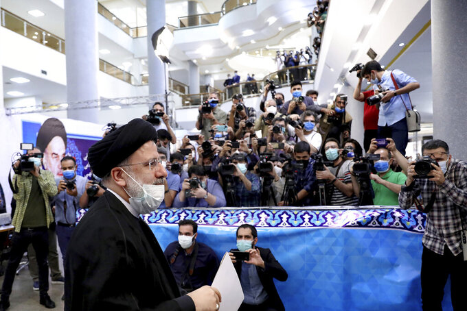 Ebrahim Raisi, head of Iran's judiciary attends the Interior Ministry to register his candidacy for the June 18 presidential elections at the elections headquarters of the Interior Ministry in Tehran, Iran, Saturday, May 15, 2021. (AP Photo/Ebrahim Noroozi)