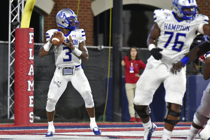 Hampton quarterback Deondre Frencois looks for a receiver during the team's college football game against Liberty in Lynchburg, Va., Saturday, Sept. 21, 2019. (Taylor Irby/The News & Advance via AP)