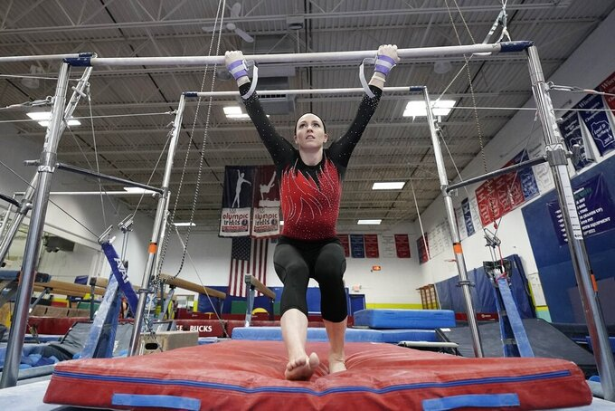 FILE - In this Feb. 18, 2021, file photo, gymnist Chellsie Memmel trains in New Berlin, Wis. The 32-year-old Memmel, a former world champion and Olympic silver medalist, will compete for the first time in nine years on Saturday at the US Classic in Indianapolis. (AP Photo/Morry Gash, File)