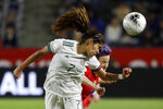 Mexico forward Daniela Espinosa, left, heads the ball away from U.S. forward Megan Rapinoe during the first half of a CONCACAF women's Olympic qualifying soccer match Friday, Feb. 7, 2020, in Carson, Calif. (AP Photo/Chris Carlson)
