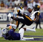 TCU's Trevon Moehrig (7) tackles Arkansas-Pine Bluff's KeShawn Williams (8) after a short gain during the first half of an NCAA college football game Saturday, Aug. 31, 2019, in Fort Worth, Texas. (David Kent/Star-Telegram via AP)