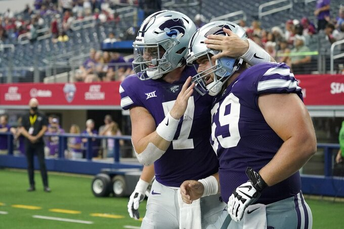 Kansas State quarterback Skylar Thompson (7) and offensive lineman Noah Johnson (69) celebrate after Thompson ran the ball in for a touchdown in the second half of an NCAA college football game against Stanford in Arlington, Texas, Saturday, Sept. 4, 2021. (AP Photo/Tony Gutierrez)