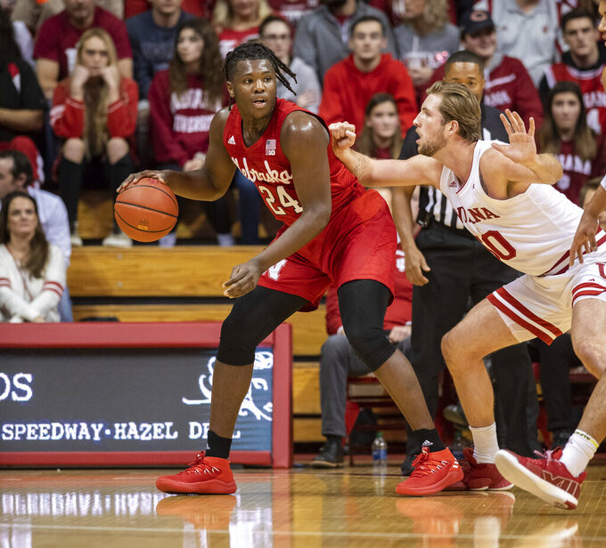 Nebraska forward Yvan Ouedraogo (24) works the ball into the defense of Indiana forward Joey Brunk (50) during the first half of an NCAA college basketball game, Friday, Dec. 13, 2019, in Bloomington, Ind. (AP Photo/Doug McSchooler)