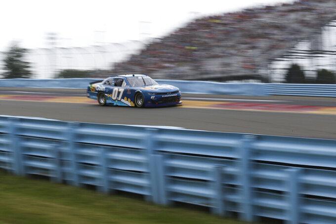 Joe Graf Jr. drives around Turn 1 in the NASCAR Xfinity Series auto race at Watkins Glen International in Watkins Glen, N.Y., on Saturday, Aug. 7, 2021. (AP Photo/Joshua Bessex)