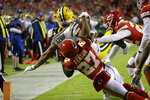 Green Bay Packers wide receiver Allen Lazard (13) is tackled by Kansas City Chiefs cornerback Rashad Fenton (27) before he entered the end zone, during the first half of an NFL football game in Kansas City, Mo., Sunday, Oct. 27, 2019. (AP Photo/Charlie Riedel)