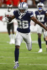 Dallas Cowboys cornerback Jourdan Lewis runs with the football after intercepting a pass by Tampa Bay Buccaneers quarterback Tom Brady during the first half of an NFL football game Thursday, Sept. 9, 2021, in Tampa, Fla. (AP Photo/Scott Audette)