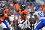 Denver Broncos quarterback Teddy Bridgewater (5) throws against the Los Angeles Rams during the first half of an NFL preseason football game, Saturday, Aug. 28, 2021, in Denver. (AP Photo/David Zalubowski)