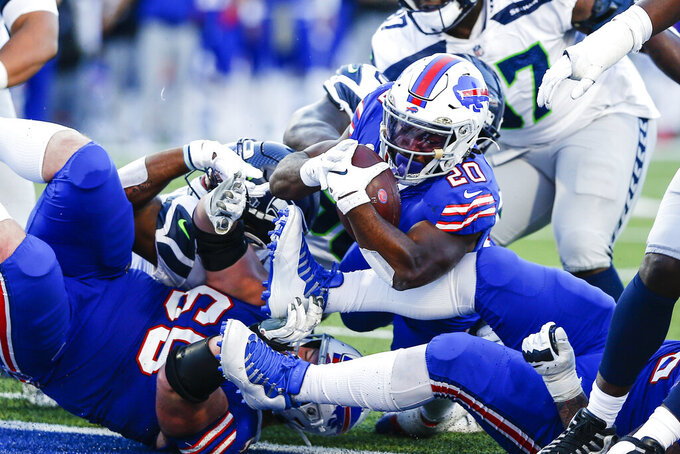 Buffalo Bills' Zack Moss (20) rushes for a touchdown during the second half of an NFL football game against the Seattle Seahawks, Sunday, Nov. 8, 2020, in Orchard Park, N.Y. (AP Photo/John Munson)