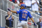 New York Mets' Francisco Lindor gestures toward the stands after he score on his home run during the ninth inning of a baseball game against the Washington Nationals, Sunday, Sept. 5, 2021, in Washington. (AP Photo/Nick Wass)