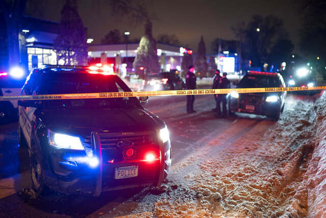 The scene at 36th St. and Cedar Ave. S. after a man was shot and killed by Minneapolis Police Wednesday, Dec. 30, 2020, in Minneapolis. Police in Minneapolis shot and killed a man during a traffic stop on the city's south side Wednesday night. Department spokesman John Elder said the incident happened about 6:15 p.m. while officers were carrying out a traffic stop with a man suspected of a felony.  (Jeff Wheeler/Star Tribune via AP)