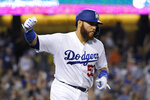 Los Angeles Dodgers' Russell Martin celebrates as he rounds first after hitting a three-run home run during the seventh inning of the team's baseball game against the Colorado Rockies on Tuesday, Sept. 3, 2019, in Los Angeles. (AP Photo/Mark J. Terrill)
