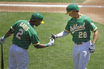 Oakland Athletics' Matt Olson (28) celebrates with Khris Davis, left, after hitting a home run off Texas Rangers' Mike Minor in the second inning of a baseball game Thursday, Aug. 6, 2020, in Oakland, Calif. (AP Photo/Ben Margot)