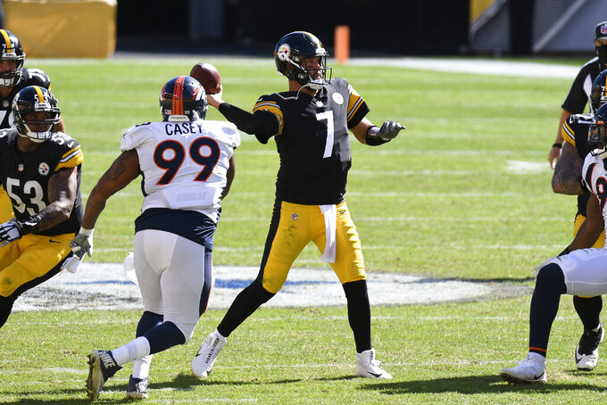 Pittsburgh Steelers quarterback Ben Roethlisberger (7) gets off a pass under pressure from Denver Broncos defensive end Jurrell Casey (99) during the second half of an NFL football game in Pittsburgh, Sunday, Sept. 20, 2020. (AP Photo/Don Wright)