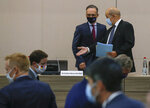 German Foreign Minister Heiko Maas, left, and French Foreign Minister Jean-Yves Le Drian wearing masks arrives for the opening session of the French ambassadors to European countries in Paris, Monday, Aug. 31, 2020. (AP Photo/Michel Euler)