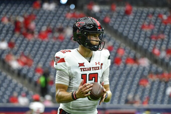 Texas Tech quarterback Tyler Shough (12) warms up before an NCAA college football game against Houston  Saturday, Sept. 4, 2021, in Houston. (AP Photo/Justin Rex)