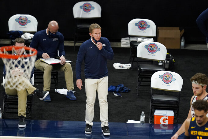 FILE - In this Dec. 2, 2020, file photo, Gonzaga coach Mark Few watches during the first half of the team's NCAA college basketball game against West Virginia in Indianapolis. Coach Few of top-ranked Gonzaga says the suspension of basketball activities for the past two weeks because of the coronavirus pandemic has ''not helped us in any way, shape or form.″ Few called it the biggest challenge he had faced as a head coach during a Zoom call Thursday, Dec. 17, 2020, as the Bulldogs prepared to face No. 3 Iowa on Saturday in South Dakota. (AP Photo/Darron Cummings, File)
