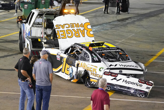 The car of winning driver AJ Allmendinger is towed away after Allmendinger crashed with Austin Cindric at the finish line during a NASCAR Xfinity Series auto race at Bristol Motor Speedway Friday, Sept. 17, 2021, in Bristol, Tenn. (AP Photo/Mark Humphrey)